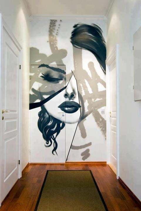 Tape art face accent wall in hallway